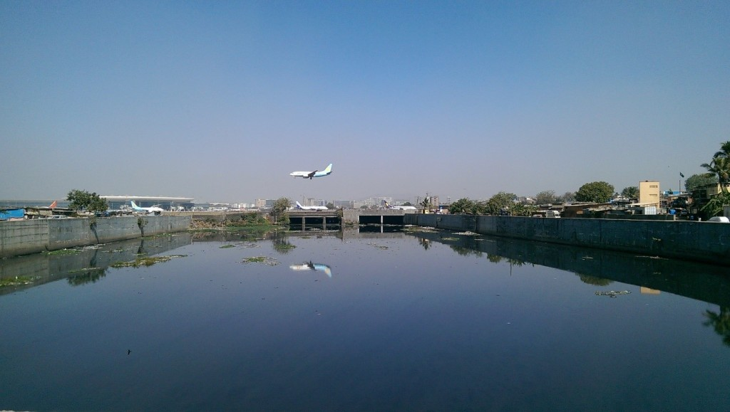 View of the bounded Mithi River next to the Mumbai International Airport. Photo: Hans Adam.