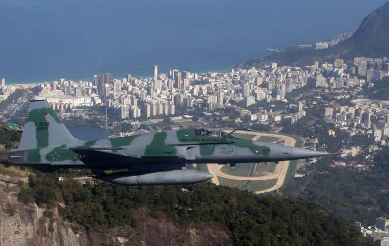 A Brazilian Air Force plane flies during an exercise ahead the Rio 2016 Olympic Games in Rio de Janeiro, Brazil. REUTERS/Stringer